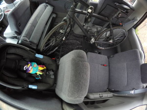 Picture of Toyota Noah interior containing road bike and child's car seat