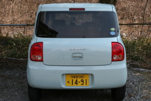 Picture of the back of a Suzuki Alto Lapin kei car.