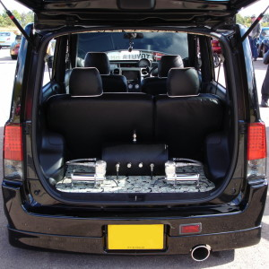 Picture of a Toyota bB with the boot open showing air suspension