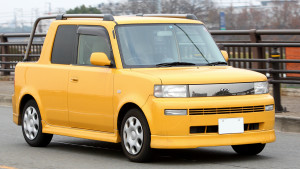 Picture of the front view of a yellow Toyota bB Open Deck