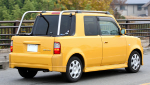Picture of the rear view of a yellow Toyota bB Open Deck