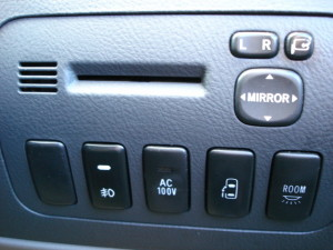 Picture of an electronic toll collection card slot in a Toyota Alphard