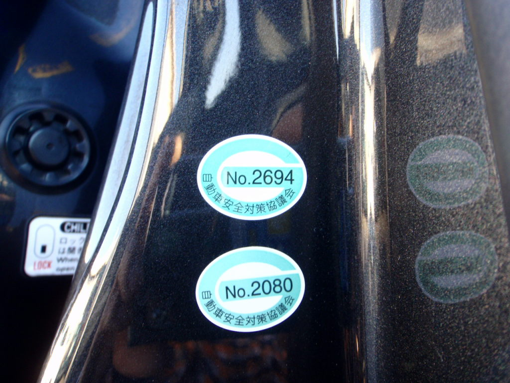 Stickers indicating Japanese import car recalls have been done