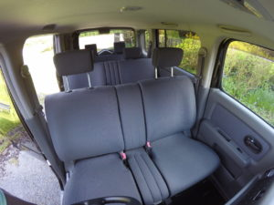 Picture of 3 rows of seats in a Nissan Cubic