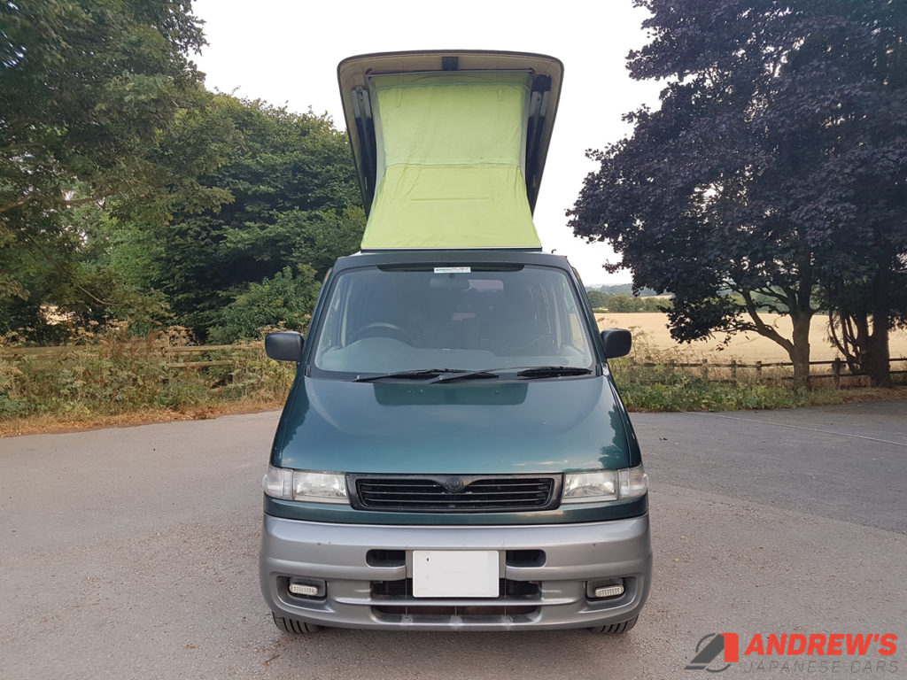 Picture of the front of Mazda Bongo auto free top for sale with roof up